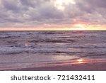 sunset on the beach. baltik sea  | Shutterstock . vector #721432411