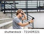 attractive teenage boy in urban ... | Shutterstock . vector #721439221