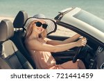 young woman drive a car on the... | Shutterstock . vector #721441459