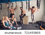 fitness models resting in the... | Shutterstock . vector #721455805
