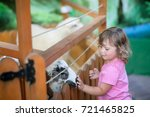 adorable toddler girl at... | Shutterstock . vector #721465825