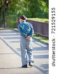 lonely asian old man walking in ... | Shutterstock . vector #721529155