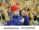 curious kid girl collects rowan ... | Shutterstock . vector #721529545