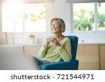 senior woman relaxing in...   Shutterstock . vector #721544971