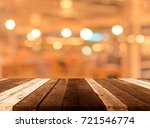 image of wood table and blur... | Shutterstock . vector #721546774