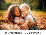 Two Happy Girls As Friends Hug...