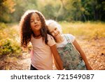two happy girls as friends hug... | Shutterstock . vector #721549087