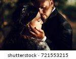 sun illuminates tender faces of ... | Shutterstock . vector #721553215