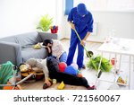 janitor cleaning a mess   Shutterstock . vector #721560067