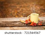 tea cup with leaves in autumn... | Shutterstock . vector #721564567