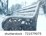 bench in a cold winter park snow | Shutterstock . vector #721579075