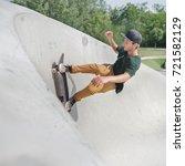 skateboard guy in action in... | Shutterstock . vector #721582129
