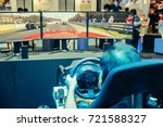 men are playing a racing game.... | Shutterstock . vector #721588327
