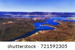 snowy river flows into... | Shutterstock . vector #721592305