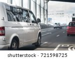 white minibus goes on the city...   Shutterstock . vector #721598725