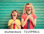 funny woman and kid with fake... | Shutterstock . vector #721599811