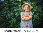 happy little girl holding... | Shutterstock . vector #721613371
