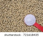feed additive in red spoon on... | Shutterstock . vector #721618435