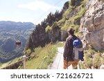man hiking mountain. man... | Shutterstock . vector #721626721