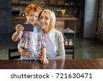 say cheese. loving grandmother... | Shutterstock . vector #721630471