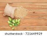 fresh green hops and grains of...   Shutterstock . vector #721649929