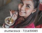 happy asian woman drinking ice... | Shutterstock . vector #721650085