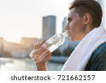serene male athlete drinking... | Shutterstock . vector #721662157