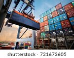 Small photo of Container loading in a Cargo freight ship with industrial crane. Container ship in import and export business logistic company. Industry and Transportation concept.
