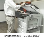 man copying paper from... | Shutterstock . vector #721681069