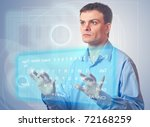 Businessman pushing a button on a touch screen. Virtual Keyboard. - stock photo