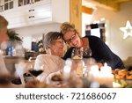 family celebrating christmas.... | Shutterstock . vector #721686067