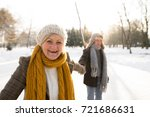 senior couple in sunny winter... | Shutterstock . vector #721686631