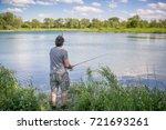 man fishing on a lake    Shutterstock . vector #721693261