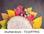 autumn leaves over wooden... | Shutterstock . vector #721697941