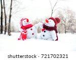 couple of snowmen taking hand...   Shutterstock . vector #721702321