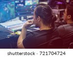 monitor man in the video shoot. | Shutterstock . vector #721704724