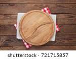 pizza board and tablecloth on... | Shutterstock . vector #721715857