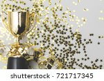 gold winners trophy with golden ... | Shutterstock . vector #721717345