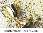 gold winners trophy with golden ... | Shutterstock . vector #721717387