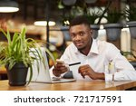 handsome african man in white... | Shutterstock . vector #721717591