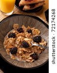 Close up of a complete healthy breakfast of cereal toast fruits and juice. - stock photo