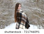 young beautiful girl in winter... | Shutterstock . vector #721746091