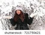 beautiful girl in winter snowy... | Shutterstock . vector #721750621