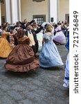 Small photo of NAPLES, ITALY - MAY 12: Ladies and gentlemen in ball suits of the 19th century inside the Chiostro of St. Lorenzo on May 12, 2013 in Naples, Italy.