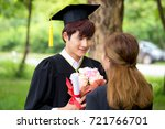 young woman give a bouquet of...   Shutterstock . vector #721766701