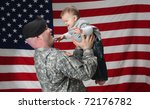 Soldier Holding His Son In The...