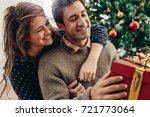 couple with gift box sitting... | Shutterstock . vector #721773064