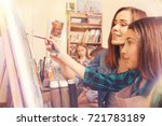 female artist helping young... | Shutterstock . vector #721783189