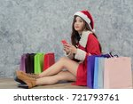 beautiful woman wearing a santa ... | Shutterstock . vector #721793761