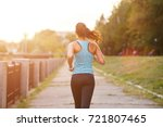 young smiling sporty woman... | Shutterstock . vector #721807465